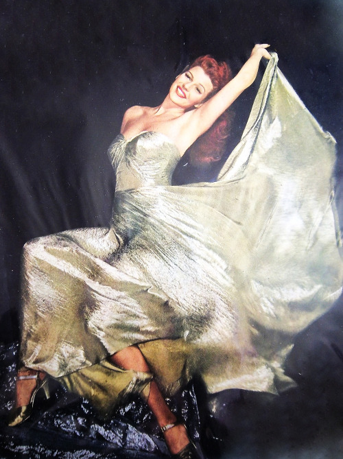 signorelli-girl:  Rita Hayworth, 1944   I wish I could swan about in a silver lamé dress swishing my skirt about.