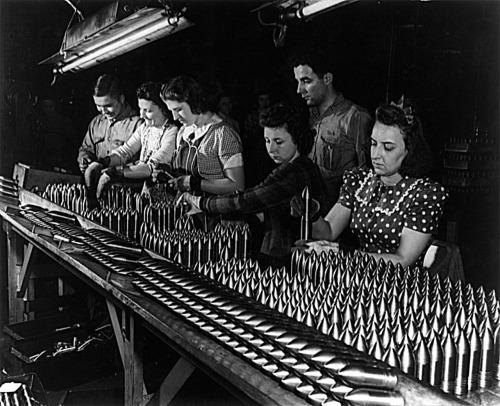 Alfred T. Palmer, Aluminum paint production. Women work alongside of men in this Midwest aluminum factory now converted to production of war materials. These young workers are assembling 37mm armor-piercing shot prior to heat treating operations, Cincinnati, Ohio, 1942. Source: Farm Security Administration - Office of War Information Photograph Collection (Library of Congress)