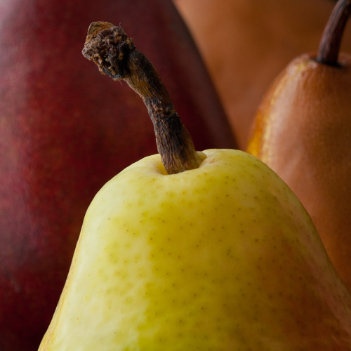 I see a head (face) at the top of the stem on the pear in the foreground… I believe there is a word for that, but it escapes me for the moment.  http://en.wikipedia.org/wiki/Anthropomorphism