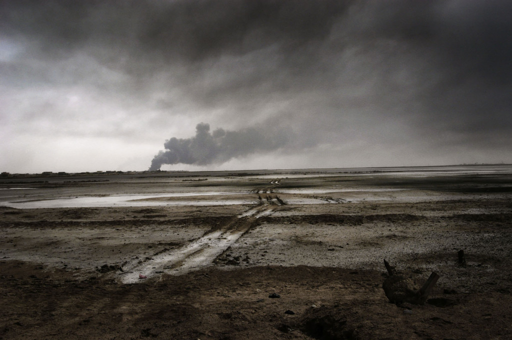 liquidnight:  Paolo Pellegrin The city of Basra in flames during the American invasion in Iraq, 2003  From the Dies Iræ (Day of Wrath) retrospective at the Maison Européenne de la Photographie [via La Lettre de la Photographie]