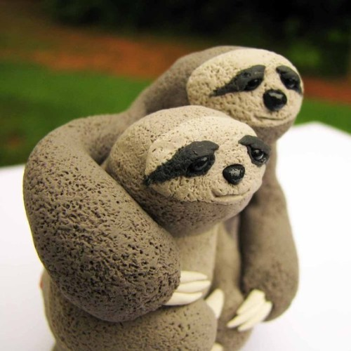 Welcome to the land of Etsy cake toppers. These sloths are adorable.  And it's no secret that Suz loves sloths.
