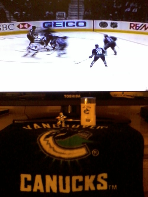 "Playoff talismans: striped blue and green Canucks facepaint (unused), towel & my lucky Elsa_Corsi ""Canadian Beauty"" 2010 Olympic brooch."