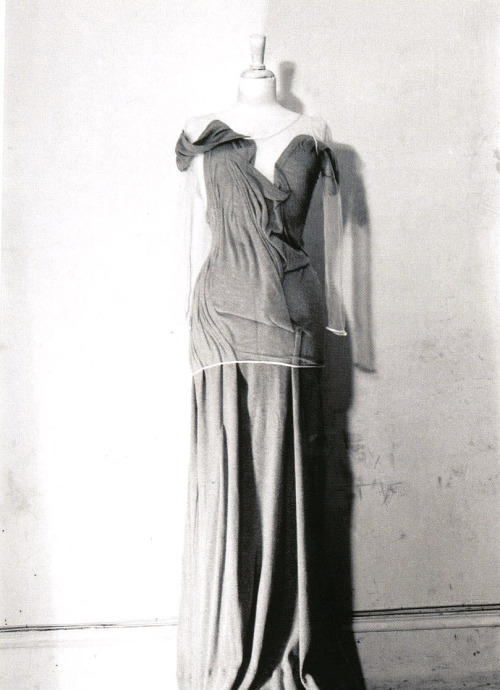 S/S 1990. Photography: Tatsuya Kitayama A 200% enlarged tank top, crushed under a skintight invisible net t-shirt, becoming a long draped dress.