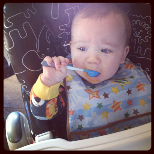 "Little B learned how to feed himself today…which is a big deal to me because, in my family, food is important. It's celebratory and an experience. My fondest food memories include lobsters my dad brought home from Maine, being introduced to sushi when I was eight and actually liking it (I clearly am still a fan), paging through Barefoot Contessa's latest cookbook (before Epicurious existed) for intriguing recipes for an upcoming dinner party with my mom and making rice crispy treats on snow days.   I married someone that also enjoys time in the kitchen (and caters to my desire to dine at every new restaurant in the city within a month of its opening). While our techniques in the kitchen may differ (he follows recipes, I alter them), together we have crafted some mouth-watering entrees and created our own traditions that I want to share with Little B. He may be too young for ""the perfectly seared steak"" or the ""white cheddar mushroom frittata"", but my little foodie is quickly developing an adventurous palette (and hopefully a set of manners to go with it) of which I am going to take full advantage!   Some of his new favs include mangos, yogurt strawberries, squash, apples, granola, peas, chicken and cucumber spears."