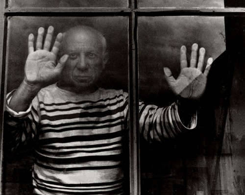 Pablo Picasso behind his window