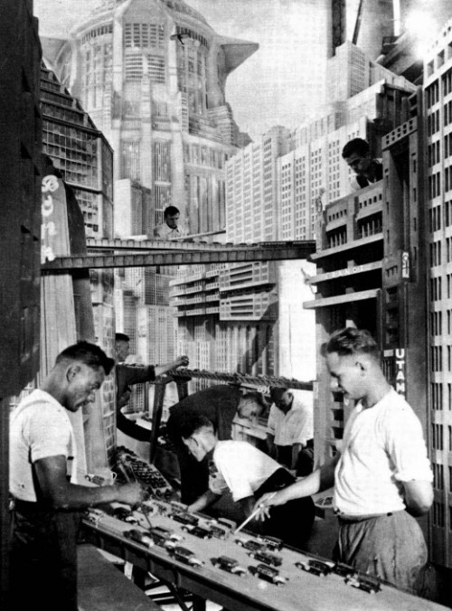 ontheset:  On the set of Metropolis  Is the dystopia depicted in Metropolis really about underground slave labour fueling a demonic industrial machine to support upper class decadence, or was the original intent like that above? That in the future giant men with sticks will prod us on our way to work?