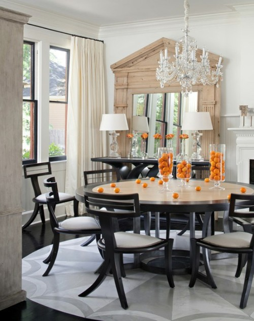 black table, orange fruits, neutral mirror