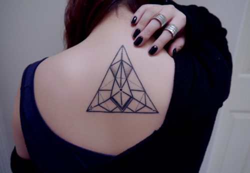 First tattoo, designed by myself.I love geometric shapes so this is what happened. Each corner has the first letter of each of my family members in braille.Done by Garrett Egle at Gastown Tattoo Parlour in Vancouver.