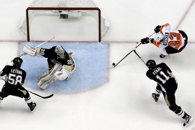 Flyers forward Jakub Voracek wrists a game-winning goal in overtime past Penguins goalie Marc-Andre Fleury (29) and Jordan Staal (11) during Game 1 of their opening-round playoff series on Wednesday. The Flyers fell behind 3-0 but scored four straight for the overtime victory. (AP Photo/Gene J. Puskar) FARBER: Flyers rally to beat Pens in memorable Game 1 DATER: Schenn, Richards among Wednesday's Three StarsVIDEO: Watch highlights of the Penguins-Flyers game