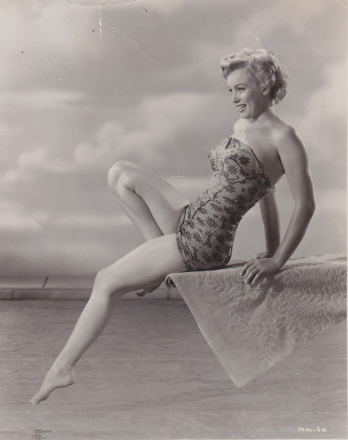 theniftyfifties:  Marilyn Monroe  Her bathing suit is doing it for me, I wish I had one like this