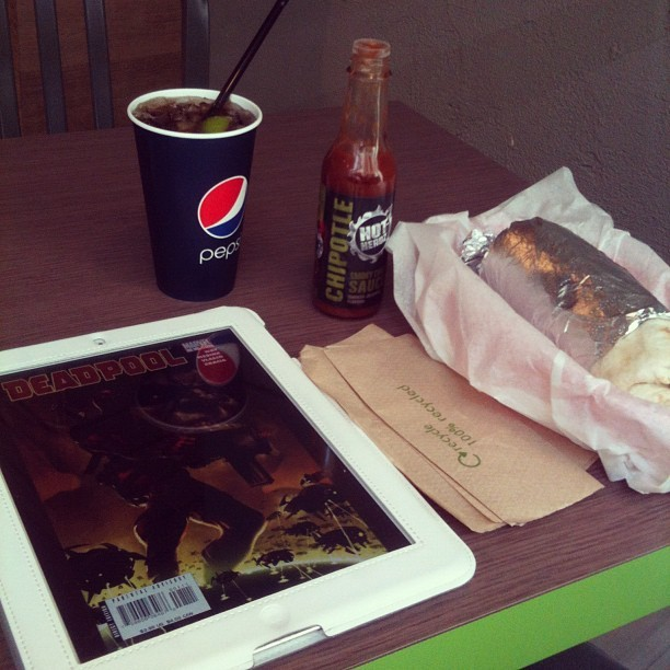 Time to start my #deadpool journey with a #burrito. #manchester #ipad #comics #barburrito (Taken with instagram)