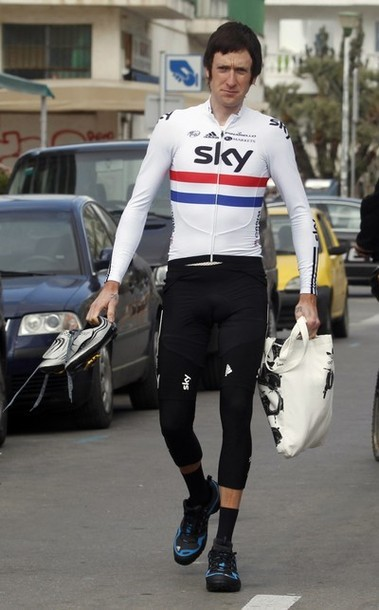 Team Sky rider Bradley Wiggins of Britain walks before the start the first stage of the 92th Volta a Catalunya cycling race from Calella to Calella March 19, 2012. Team GreenEdge rider MIchael Albasini of Switzerland won the stage. (via Photo from Reuters Pictures)