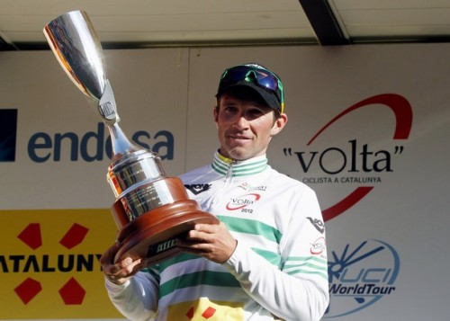 Team GreenEdge rider Michael Albasini of Switzerland celebrates with the trophy on the podium after winning the first stage of the 92th Volta a Catalunya cycling race in Calella March 19, 2012. (via Photo from Reuters Pictures)