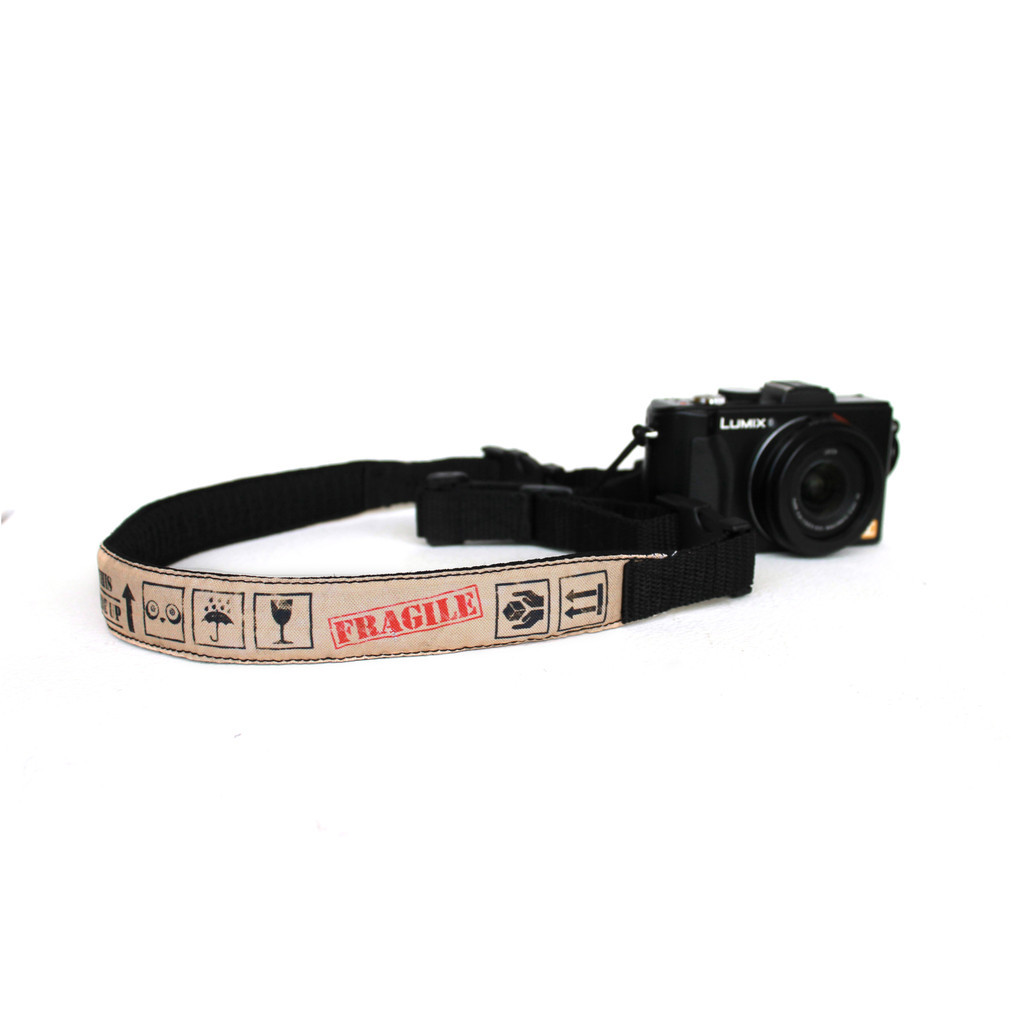 Compact camera straps now available at www.punchdrunkpanda.com! Available in 4 awesome new designs. Yay!Also available for DSLRs. Double yay!Check them out now! :D Featured design above is the Handle With Care design by Jen Horn.
