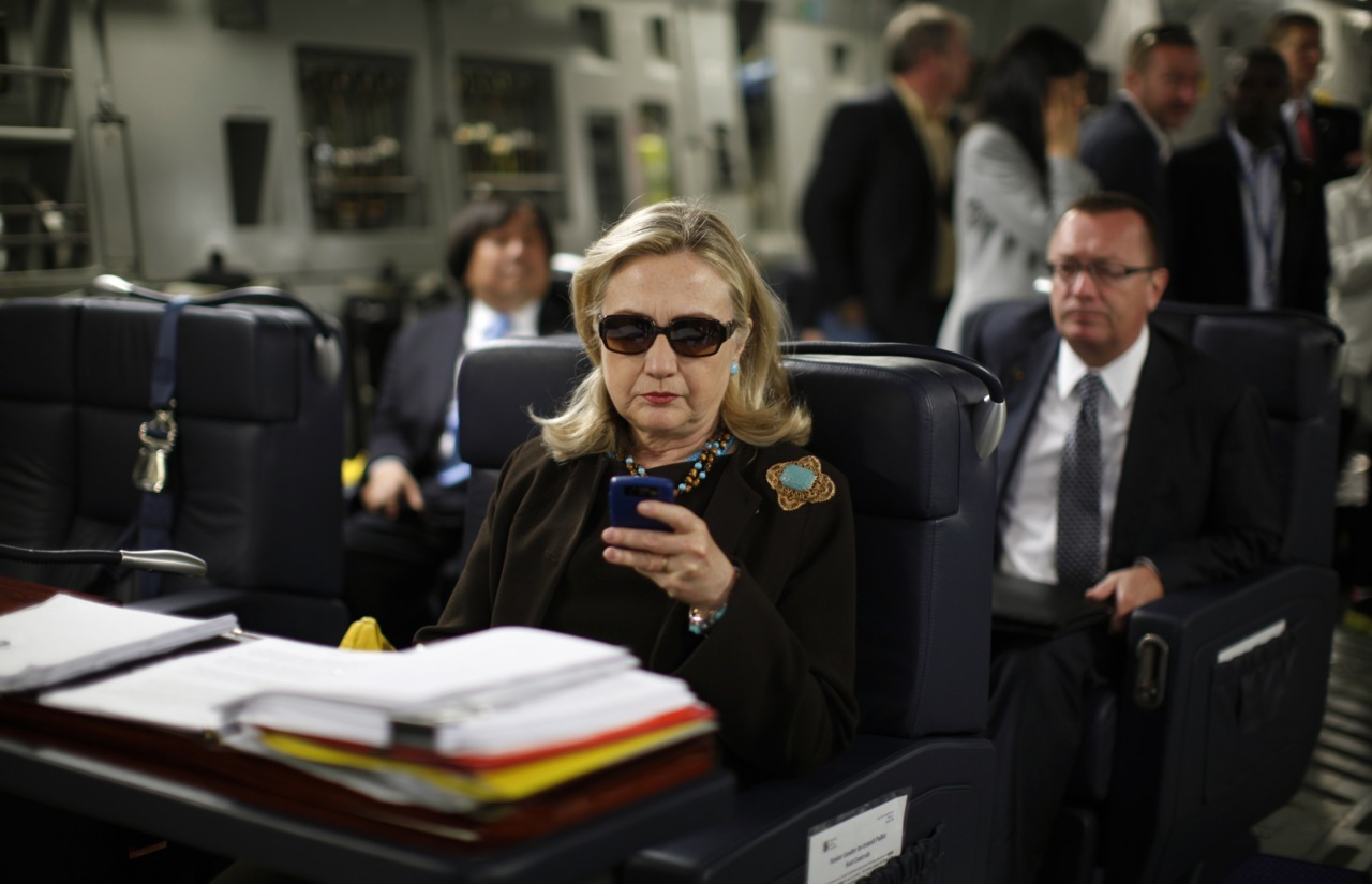 "reuterspolitics:  ""Texts from Hillary"" — go figure! On a secretive trip by Secretary of State Hillary Clinton to Tripoli, only days before the capture and killing of Libyan leader Muammar Gadaffi, I photographed Clinton aboard a C-17 transport plane. She was wearing dark sunglasses while texting from a makeshift desk she was working from. Okay, nice image I thought, but we were about to land in Tripoli which was certain to yield the images that the world would really want to see. Initially yes. But that was last October.  In the past week, that image of Hillary texting on the plane has gone viral thanks to a tumblr.com blog called ""Texts from Hillary"" which used my image, along with a similar one from photographer Diana Walker, for a meme which according to the creators of the blog resulted in ""a week that included 32 posts, 83,000 shares on Facebook, 8,400 Twitter followers, over 45K Tumblr followers, news stories around the world."" The blog went so viral, that the creators of the tumblr blog, Adam Smith and Stacy Lambe were invited to the State Department where they met with Secretary Clinton who according to Smith found the site much to her liking. The icing on the cake was having their photo taken with Clinton as they all texted.  Read more of this story from photographer Kevin Lamarque"
