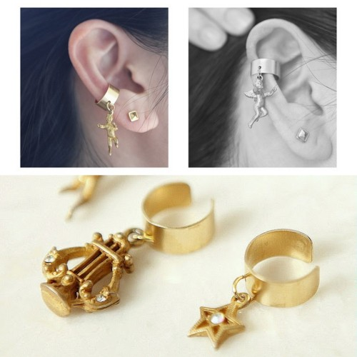 DIY Ear Cuffs with Charms. The ear cuffs were bought on Etsy (they run about $.50 to $1 a piece here and most come drilled with a hole so you can easily add a charm, chain, etc…). Pretty basic how-to from Hello Whimsy Blog here.