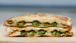 gossipchef:  Asparagus Grilled Cheese      INGREDIENTS 8 thin stalks asparagus, tough ends broken off 1 tablespoon olive oil Salt and pepper to taste 2 teaspoons grainy mustard 2 slices gruyere cheese 2 slices of bread 1 tablespoon soft butter DIRECTIONS 1. Preheat oven to 425 and toss the asparagus in the oil, salt and pepper. Arrange the asparagus in a single layer on a baking sheet. 3. Roast the asparagus for about 10 minutes or until tender and a little crispy on the outside. 4. Spread one side of each piece of bread with butter.. Place one slice of cheese on the unbuttered side, lay asparagus in a single layer on top of cheese, and top with a second slice of cheese. 5. Heat a frying pan over medium heat and grill slowly until the cheese has melted and the bread is golden , about 2-4 minutes per side.