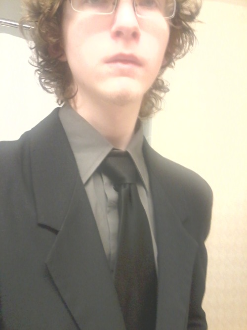 Remember when I wore a suit. Look at how short my hair was Jesus Christ.