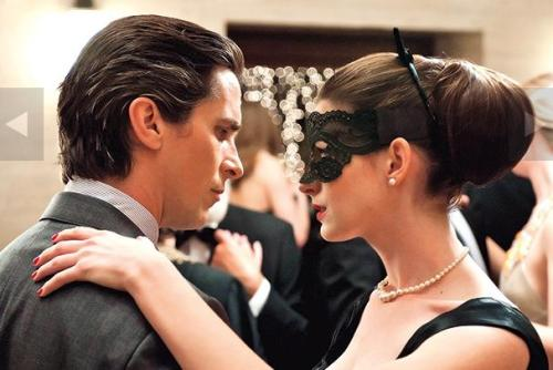entertainmentweekly:  More Dark Knight Rises goodness on EW.com today — check out these 7 new photos from the film. Click through to find Bane, Wayne, and JGL as beat cop John Blake.