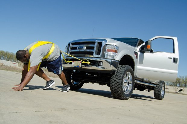 The Chargers' Tyronne Green pulls a Ford F-250 truck as part of his offseason conditioning program at the O-Line Academy in Avon, Ohio. Photo by Al Fuchs