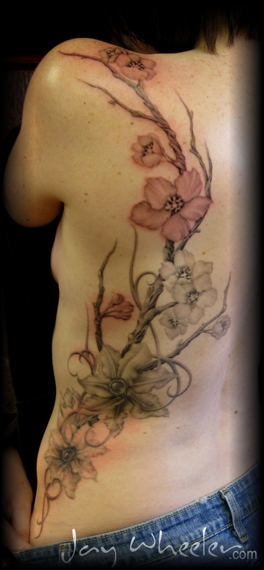 fuckyeahtattoos:  Flowers on Ribs by Jay Wheeler Jaywheeler.com