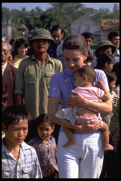unicef:  UNICEF Goodwill Ambassador Audrey Hepburn is accompanied by children on a walk in the hamlet of Phuc Ly, Phu Minh Commune, Tu Liem District near Hanoi.  Audrey Hepburn's visit to Vietnam in October/November of 1990 contributed to drawing world attention to the needs of children in this aid- starved country. UNICEF cooperation in Vietnam focuses on increasing primary health care outreach including immunization, growth monitoring and maternal care; the construction of handpumps and latrines to extend safe water and sanitation availability; and support for daycare centres and universal primary education including the training of teachers and supplies provision. UNICEF also directs special attention to the country's isolated minorities.Viet Nam © UNICEF/NYHQ1990-0081/Peter Charlesworth http://www.unicef.org