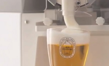 theweekmagazine:  Say goodbye to warm beer: A Japanese brewing giant, is topping off beer mugs with frozen beer foam, dispensed like soft-serve ice cream. The manufacturer says the frozen foam can keep a stein of beer cold for 30 minutes. Check it out