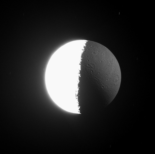 ckck:  Dione lit by the sun and sunlight reflected off of Saturn. March 22nd, 2008. Photographed by the Cassini Orbiter.