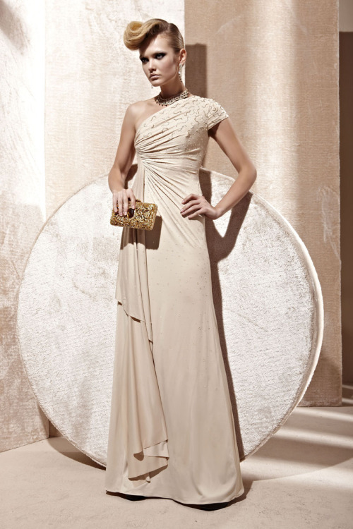 Cream Asymmetrical Evening Dress With Beading £260.00  Discreet ocassion evening dress in soft cream colour featuring asymmetrical A Line silhouette, full length satin skirt, ruched on the side to create more curves embellished with gorgeous crystals on bodice and confetti beading on neckline and short sleeve. Send us a message to inquire about our plus size or if you like this dress in another colour of your choice.