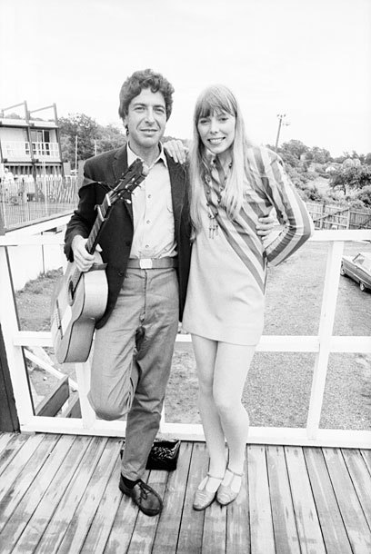 "ilovejonimitchell:  Leonard Cohen and Joni Mitchell at the Newport Folk Festival in 1967 Photo by David Gahr  I've been meaning to write an essay about LaLa Vasquez-Anthony and how great her show is and how it so subtly turns the athletes-dating-reality stars thing on its ear by HUMANIZING its subjects and faceting their identities in a really not offensive way. Hasn't happened yet. A few weeks ago, while I couldn't sleep, I realized that ""Famous Blue Raincoat"" was about dropping out of Scientology. I thought about this and about whatever I had been watching on TV and decided that  I would write something called ""Famous Blue Birkin"", talking about Khloe Kardashian's sad blue Birkin that she trotted out at the beginning of the season as a metaphor for aspiration and affect, and the idea that reality TV has made fame-religions like Scientology a little passe. For now this picture will have to do."