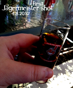 "JägermeisterOh man, where the hell do I begin?  I love my husband's family. To make a long gay story short, it took a few years before I was successfully a part of of his family—attending weddings, gatherings, holidays and any other event a family does together. It was not anyone's fault, it was complicated. But it's all in the past now and has been for about 4 wonderful years.Let me set the stage: Joe's the baby boy of the oldest sibling from a very Catholic family of 8. That makes 7 sets of active, engaged aunts and uncles, 5-6 of which we see pretty frequently. Lots of cousins, spouses, in-laws. It's a pretty large, loving family.I often joke that I am the closest thing this family has to a black/jewish/disabled family member—you know the one that's decidedly different. And to be fair, that's completely inappropriate. I'm way worse than any of those examples for this family.Oh, it's not the ""gay thing"". They don't really seem to care about that. It's my weird, dark sense of humor and my mouthy mouth. Poor Joe's mother and grandmother, they're always finishing my sentences with ""Oh, Ben…"" and ""Now Ben…"" and ""You're terrible…""And for the most part, I'm pretty well behaved around them. What they mostly get is the stuff I can't seem to control. For you see, I have this weird brain-to-mouth connection problem.My brain thinks something terrible/inappropriate/dark&twisted and my mouth says ""Say no more, I'm on it…"" and BAM! It goes out unchecked.  Often funny, but rather unchecked.I've suffered with this all my life. I should really start a charity.Ok, back to my point. While there are certainly darker-horse family members who wildly appreciate my verbal stylings and sometimes contribute their own wealth of madness, for the most part Joe's family is pretty kind and lovely and sedate. Oh sure, I will hear the occasional teenage war stories. You can't be one of 8 siblings growing up in the 60's & 70's and not have some great adventures, but time does tame the wild beasts.So when Joe's youngest Aunt Beth excitedly asked me ""Oh my gosh, are you having one of your new drinks?"" with wild wide eyes and this crazy look of anticipation? I didn't know what to expect.Now, don't get me wrong. Several folks in Joe's family like to have their fair share of drinks. Mixed, wines, beers: they're not Amish. But I was not expecting her to bring out a fully chilled bottle of Jäger. And I was certainty not expecting her to bring out shot glasses. On Easter.In that very moment I was simultaneously happy, shocked, amused, proud and at one with the universe. One of my very favorite things in life is to be surprised/amused by something I would have never anticipated. A dog that speaks, polite urban youth, Diet Dr. Pepper tasking like regular Dr. Pepper… you get the point.So this was pretty badass and I was pretty pleased. And while I'm sure people were poised to be amused by my anticipated reaction to Jäger, I was aware that it tasted like black licorice. And I just happen to LOVE black licorice. Oh, Jäger. Of course it has this thick, sweet strap of black licorice but with hints of leather and burnt cola. Its intense with it's rich sting of alcohol and coats your throat nicely. There is this almost lemon cola finish that's sticky sweet.It's tasty, strong, robust. I understand why one might think that a virgin would shudder at it's taste, but for me it was everything I hoped for and then some. And I appreciated the black boot kick to my sinuses. I was very happy and I'm looking foward to future Jägermeister based cocktails and drinks. The family was pleased. While I could tell they wanted me to flinch—and I did, I am human—they were excited I liked it. It made me even more normal to them. And their contribution to the Adventure made them more normal for me.Not that there were problems before with normalcy, but now I can officially say—with only a little irony—that alcohol brought me even closer to my catholic in-law family. In moderation of course. Like any visit with me, always in moderation.Cheers, BenPS: My first sets of Ohio-based firstdrink Adventures is about to come to a close with tomorrow's final post: a margarita with our Aunt Peggy. I'd been looking forward to that drink for a while. You should be too. Until then…"
