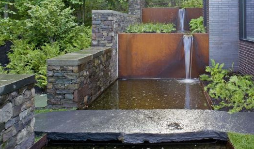 Corten steel waterfall in a Quaker Smith Point, Vermont (U.S.) private garden. Designed by Vermont firm, H. Keith Wagner Partnership. Check out that bridge stone.  Pretty amazingly big.