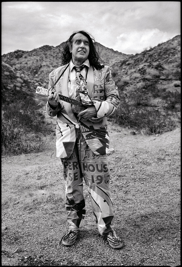Tiny Tim - musician - Arizona  © Jim Herrington Tiny Tim would have been 80 years old today. Somewhere outside of Bullhead City, AZ I woke him up and made him get out of the rental car for this picture.