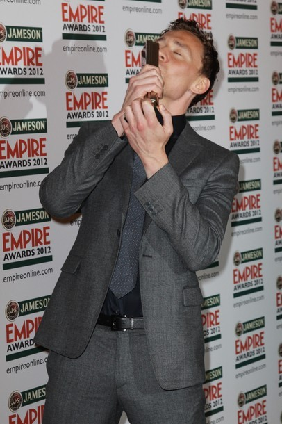Tom Hiddleston poses with his Best Male Newcomer Award at The Jameson Empire Awards 2012 at Grosvenor House on March 25, 2012 in London, England.