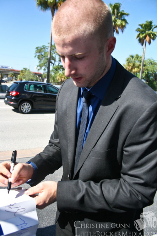 Tom Pyatt signing an autograph for a fan before heading into the Forum at the final home-game for the Tampa Bay Lightning.  Photo by Christine Gunn. See more photos here