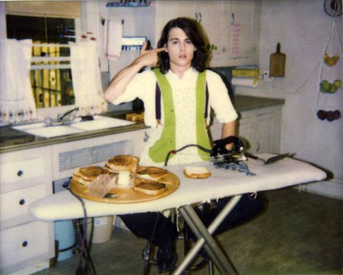 Johnny Depp making grilled cheese sandwiches with an iron.