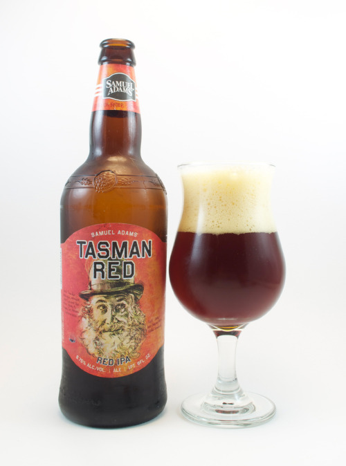 "Samuel Adams ""Tasman Red""  82 B-    This is an amber ale labeled ""red IPA,"" part of Sam Adam's limited release series. It pours an impressive head, which lasts a very long time, and leaves dense lacing behind. Very sudsy.  The aroma is characteristically ""amber,"" but with a nice citric hop accent. Warm, mellow, sweet grain malt which is lightly toasted like fresh toaster bread. A spice element brings in a subtle note on the back end.  Samuel Adams says ""this wily red IPA gets its character from the Tasmanian hops that are full of grapefruit, pine, and earthy notes."" There is indeed a bit of grapefruit and a dash of pine, but nothing like a proper red IPA should be. The malt falls somewhere between caramel and lightly roasted. It's well-rounded, not at all rough along the edges. Very smooth, with a bit of a dry, hoppy finish. Sort of a peanut brittle, caramelesque malt sweetness with an earthy appeal. Also has this nice floral appeal. to it, sort of rosey. However, the flavor falls short of expectations. The carbonation is too moderate, hops are understated (especially for a beer labeled IPA), and the palate just doesn't blend quite right. Something about the feel comes across rather flat, though creamy.  Turns out the appearance is the best feature of this brew. Sure, it's east coast, but come on. Where do these guys get at labeling this an IPA? I think I'd have more respect if they had just called it an amber ale (and I'd have probably rated it higher too.) Obviously, some market pressure has been placed on Boston brew from the finer craft breweries producing IPA hybrids. This just doesn't match up to the better guys out there. Sam Adams fails again. Sorry east coast. Not recommended.  Hops: Tasmanian  6.75% ? IBU Boston, Massachusetts"