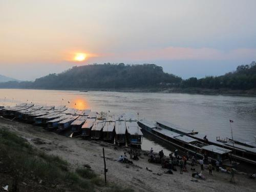 Sunset at the dock at Luang Prabang.   Click here to see more Laos photos!
