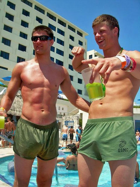 A couple of sexy cadets, freeballing poolside.