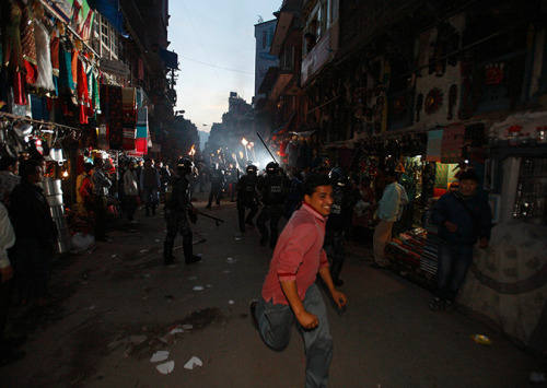 24 Hours in Pictures, 12 April 2012 Kathmandu, Nepal: Police clash with members of the Mohan Baidya faction of the United Communist Party of Nepal during a torch-lit rally Photograph: Navesh Chitrakar/Reuters