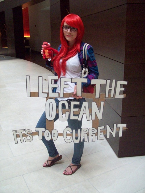 Hipster Ariel left the ocean because it's too current. Ha! That's some awesome hipster cosplay. Fish tails are probably too mainstream as well. [Photo via Don't Stand There Gawping]