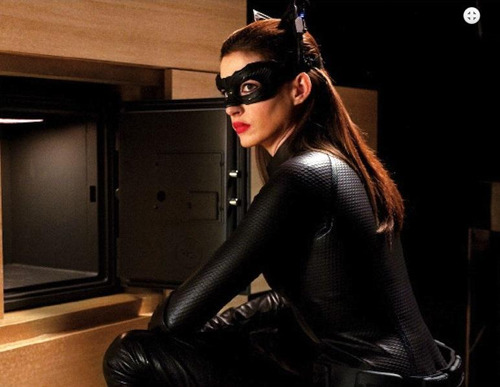 totalfilm:  New images for The Dark Knight Rises The Dark Knight Rises has debuted a clutch of new images in the latest Entertainment Weekly, including new looks at key players Bane, Catwoman and Batman himself.The latest shots show Bane on another terrorist rampage, Catwoman in her slinky new suit and Batman in what looks like a much more lightweight version of his…  she looks….okay…