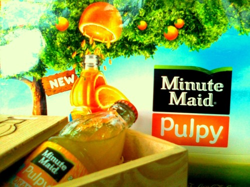 "So, Where Is The Pulp? *chews* One Catherine Mudachi (Senior Marketing Brand Manager, Coca-Cola Kenya) dropped by the office one morning during my show [1 FM Breakfast] and left me this tantalising little package. *swirls tongue in mouth, chews* [I know a couple of minds that went off on a tangent the moment I mentioned ""little package."" Yes, I'm looking right at you two, Ess and Soraya.] *sips, chews* Quick one: When are these coming in 6-packs? I need my house stocked with bottle upon bottle of this stuff. *still chewing* *-*-* Sidebar: One tiny little thing I thought I'd mention: I took that photo on my humble little phone. A Symbian. Nokia C-05 to be specific. [Good afternoon Mwirigi.] In your face, Instagram. *chews*"