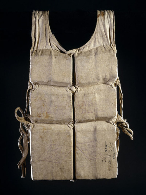 usagov:  Image description: A life vest used by a survivor of the RMS Titanic. Five days into its maiden voyage in 1912, the White Star ocean liner Titanic struck an iceberg at full speed in the North Atlantic, en route from England to the United States. At 2:20 a.m. on April 15, the gigantic ship sank in 12,500 feet of water 350 miles off the coast of Canada. Within about two hours, the ocean liner Carpathia arrived and rescued the Titanic's 705 surviving crew and passengers. Around 1,500 people aboard were lost. Chicago physician Dr. Frank Blackmarr, a Carpathia passenger, helped with the survivors suffering from hypothermia, exposure, and shock. He collected this Titanic life vest during the voyage as a souvenir, and later donated it to the Chicago Historical Society. In 1982, the CHS donated it to the Smithsonian's National Watercraft Collection. Image courtesy of the Smithsonian National Museum of American History.