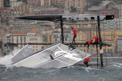 CAPSIZED CREW: Artemis Racing team members struggled to recover after their vessel capsized during an America's Cup World Series race off Naples, Italy, Wednesday. (via Photos of the Day: April 11 - Photo Journal - WSJ)