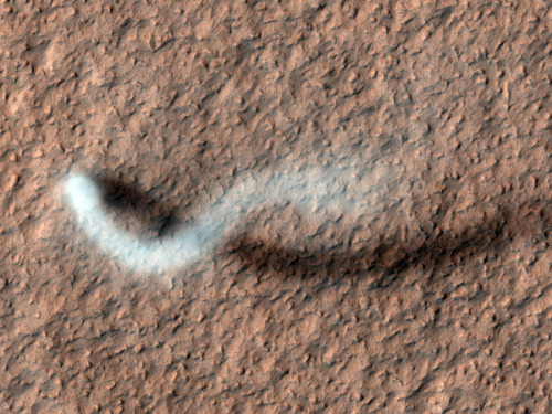 (via APOD: 2012 April 13 - A Dust Devil of Mars) The HiRISE camera on the Mars Reconnaissance Orbiter captured this shot of a dust-devil, a column of swirling, rising dust formed when the surface is heated and convection currents form in the air, sometimes beginning to rotate. Note, the dust devil is not moving in the direction that the plume would seem to imply, that is only an effect of the winds in the atmosphere blowing from the west. Credit: HiRISE, MRO, LPL (U. Arizona), NASA
