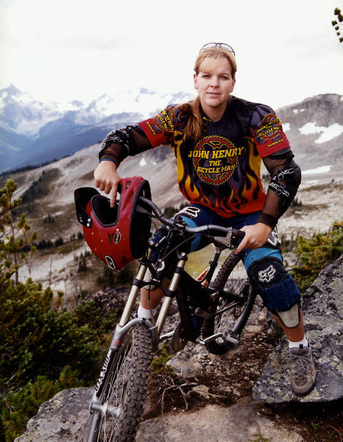 "Michelle Dumaresq is a Canadian and professional downhill mountain bike competitor.  Dumaresq had SRS performed in 1996, after having been on hormones for a lengthy period of time.  She entered the sport in 2001, six years after completing SRS, when she was discovered riding on Vancouver's North Shore by several top women mountain bikers. Dumaresq was quite open about her history as a trans woman. The women, who were filming an independent film on female mountain bike riding, suggested Dumaresq consider racing and also invited Dumaresq to appear in their film, called ""Dirt Divas."" The first event Dumaresq entered was the Bear Mountain race held in Mission, BC in May 2001. She entered the novice female class and won. In fact, her finish time was 2.5 seconds faster than the winner of the female professional category. After racing two more races, her license was suspended by Cycling BC due to complaints from female competitors.  Cycling BC and the Canadian Cycling Association met privately with local organizers and at first suggested that Dumaresq quit racing. After discussion with the UCI the decision was made to permit Dumaresq to continue competing in the women's category.  In April 2002, she was awarded a license to race in the women's category. Three weeks later, she entered her first race in the pro women's class and finished 3rd. The following week she placed 1st, beating her competition by 10 seconds. A wave of protest ensued and a petition was created and signed by female (and a few male) racers, asking for Dumaresq to be disqualified. Because she had a race license, the request was denied and her first professional win with females was upheld.  Dumaresq went on to win the 2002 Canada Cup series, which qualified her for the Canadian National team. Later on, in September 2002, she co-represented Canada at the World Mountain Bike Championships. However, due to technical issues with her bike, Dumaresq only managed a 24th place finish in the event.  In 2003, Dumaresq won the 2003 Canadian National Championships and again represented Canada in the 2003 World Championships. She repeated her Nationals win in 2004 and finished 17th at the 2004 World Mountain Bike Championships held in Les Gets, France.  Since 2004, the International Olympic Committee, whose rules are used commonly throughout competitive sport, has allowed transsexuals to compete as their reassigned gender if the surgery has taken place at least two years prior to the competition and if the athlete has been on a regimen of hormones equal to that of a person born to the gender."