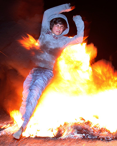 Tbilisi, Georgia A boy jumps through a fire during the Chiakokonoba folk festival. According to legend, fire leaping purifies the spirit of participants (via guardian.co.uk)