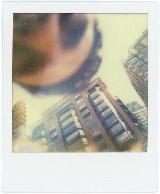 Polaroid SX70 041112 001 on Flickr. An accidental self portrait of me trying to fix my camera.