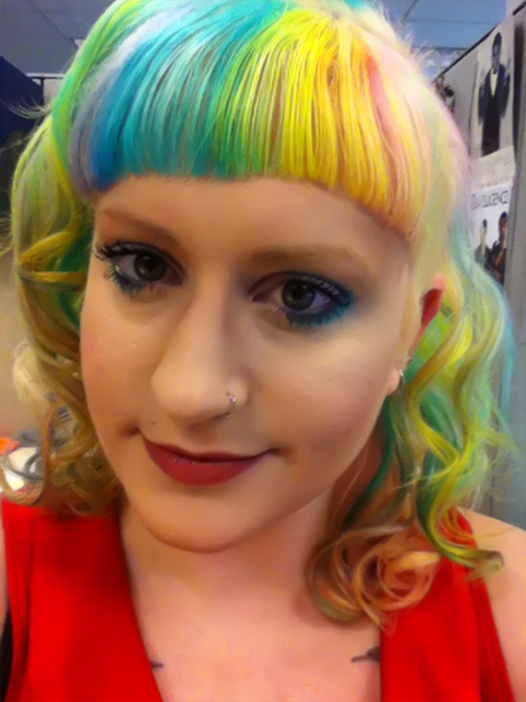Rainbow hair, redux. The pink is too light and there's too much yellow and it's too neon, but ya know, work in progress and all. Oh, and I over-bleached and kind of fried it, whoops!   I will try again with the pink and purple over the weekend so it is more balanced.